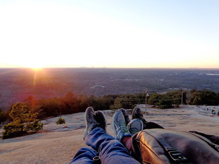 Laying down on top of Stone Mountain at sunset